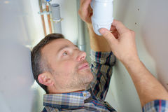 Making sure pipe tightly sealed Stock Photos