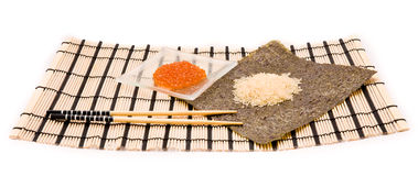 Making Sushi on a bamboo sushi mat Stock Photography