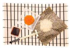 Making Sushi on a bamboo sushi mat Stock Image