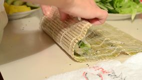 Making sushi and california rolls stock footage