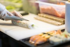 Making sushi in japanese restaurant stock photos
