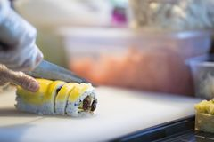 Making sushi in japanese restaurant stock photo