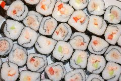 Making sushi rolls Stock Image