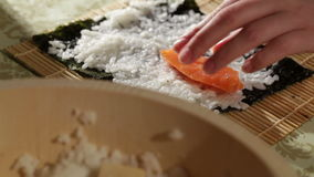 Making sushi rolls with salmon and philadelphia cheese. stock footage