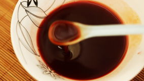 Making sweet vine sauce - closeup stock video footage