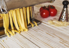 Making tagliatelle with a traditional pasta machine stock photography