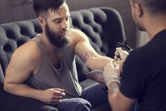 Making a tattoo Royalty Free Stock Image