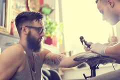 Making a tattoo Stock Photos