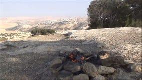 Making tea on bonfire stock video