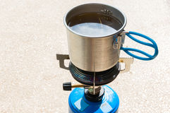 Making tea on camping stove Stock Photo