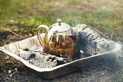 Making tea or coffee in the campfire on nature Stock Image