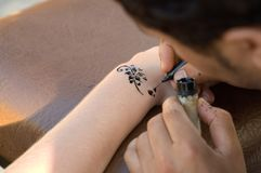 Making temporary, henna tattoo Stock Photos