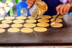 Making thai crispy pancake - cream crepes Stock Photo