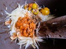 Making of thai papaya salad. In mortar Stock Photography