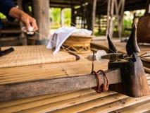 Making Thai Silk at Jim Thompson`s Farm royalty free stock photo