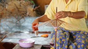 Making of Thai style paper umbrella stock video footage
