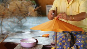Making of Thai style paper umbrella stock footage