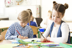 Making their first work of art. School kids concentrated on drawing during classes of art Stock Photo