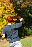 Making the Throw. Teenage boy reaching back to throw the baseball stock image