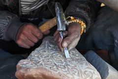 Making Tibetan Buddhist Mani Stone Stock Photo