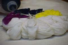 Making a tie-dye shirt royalty free stock image