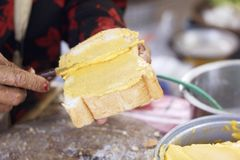 Making toast with butter and sprinkling with sugar. Royalty Free Stock Photography