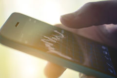 Making trading online on the smart phone Stock Images