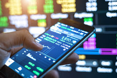 Making trading online on the smart phone. New ways to make economy stock photos