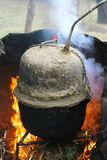 Making traditional alcohol. In a boiler on fire Stock Photo