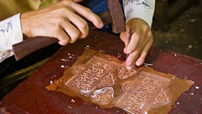 Making traditional coinage. Cambodia,Siem Reap stock video