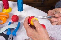 Making traditional pelota balls. Expert hands crafting  leather balls for traditional pelota sport Royalty Free Stock Photography