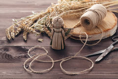 Making traditional straw toy angel with wing Stock Images