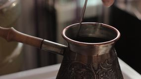 Making traditional turkish coffee in vintage bronze.  stock video footage