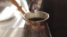 Making traditional turkish coffee in vintage bronze.  stock video