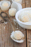 Making truffles white chocolate with coconut. Homemade candy Royalty Free Stock Images