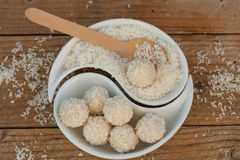 Making truffles white chocolate with coconut. Homemade candy Stock Photo
