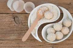 Making truffles white chocolate with coconut. Homemade candy Royalty Free Stock Photos