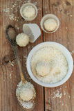 Making truffles white chocolate with coconut. Homemade candy Stock Images