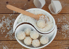 Making truffles white chocolate with coconut. Homemade candy Stock Photography