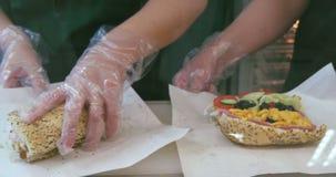 Making tuna sandwich. In fast food stock video