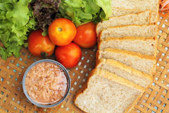 Making tuna sandwich with fresh vegetables Royalty Free Stock Images