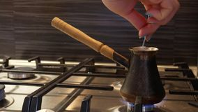Making turkish coffee in copper cezve stock footage