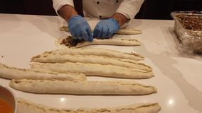 Making Turkish Style Pide step 3 closing the dough.  stock video footage