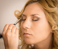 Making-up a woman Stock Photo