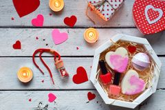 Making Valentine beauty gift. Various bath accessories. Items for the spa in pink color. Valentine`s Day background. Happy lovers royalty free stock photography