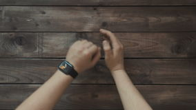 Making various gestures with a finger on a touch screen of a smart watch wearable device. stock video