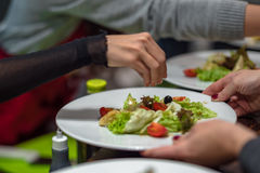 Making of vegetable salad. By people royalty free stock photography