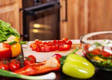Making a vegetables salad - closeup of cutting board Royalty Free Stock Photography