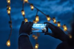 Making a video with the smarphone. At New Year`s Eve Stock Photography