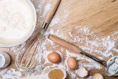Making waffles at home - batter in bowl, eggs and corolla. Cooking background stock image
